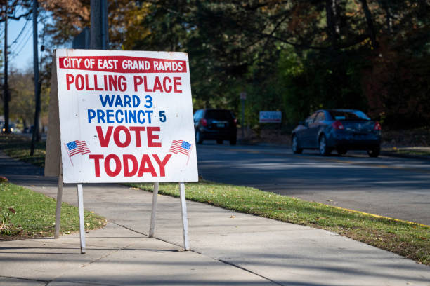 Polling Place East Grand Rapids, Michigan: A sign outside a polling station on November 3, 2020. joe biden stock pictures, royalty-free photos & images