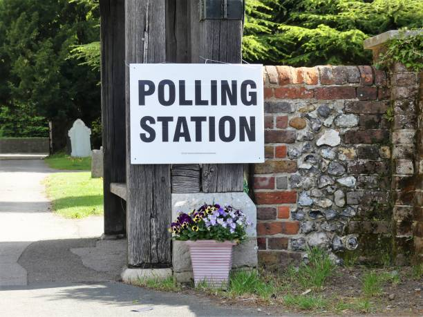 uk polling station sign at church premises - polling place stock pictures, royalty-free photos & images