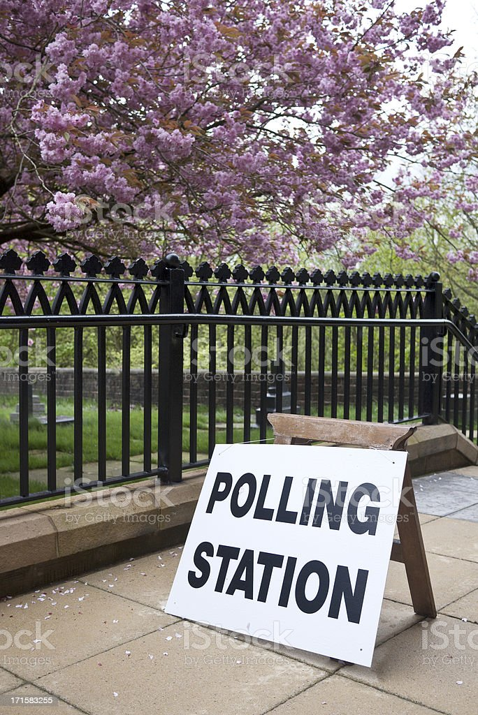 Polling station sign outside building royalty-free stock photo