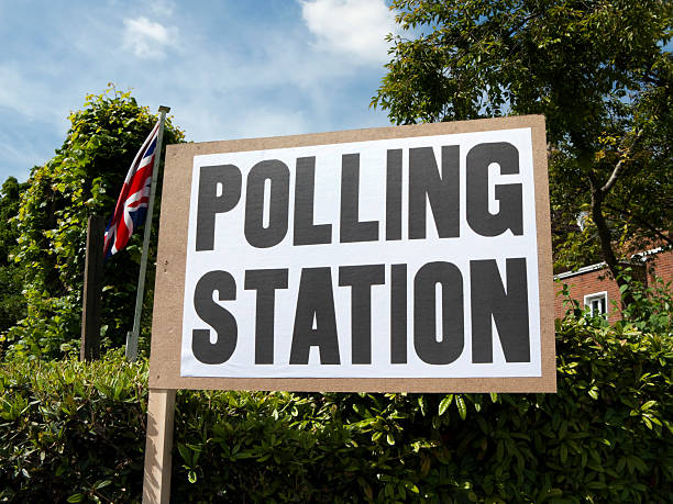 uk polling station sign with union jack - polling place stock pictures, royalty-free photos & images