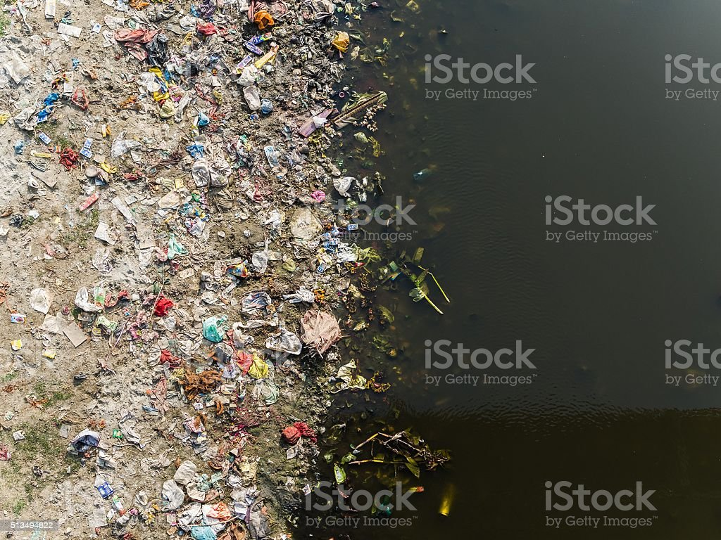 Polluted river banks stock photo