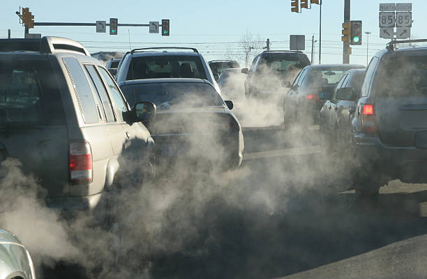 Polluting clouds of exhaust fumes rise in the air Denver Colorado stock photo
