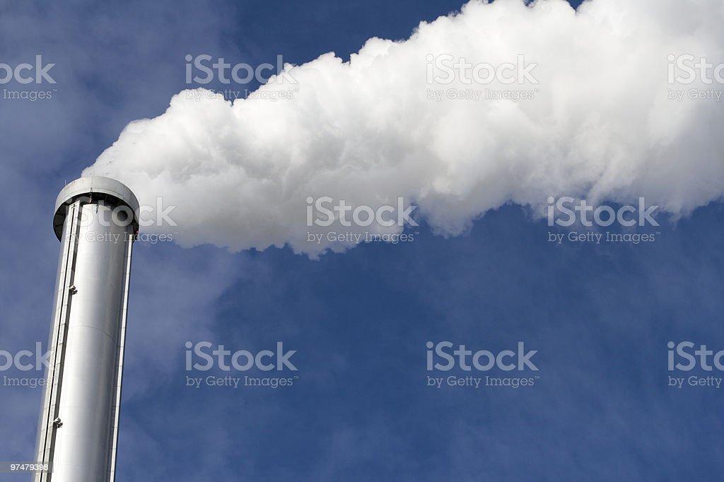 Polluting smokestack outside of Paris France royalty-free stock photo