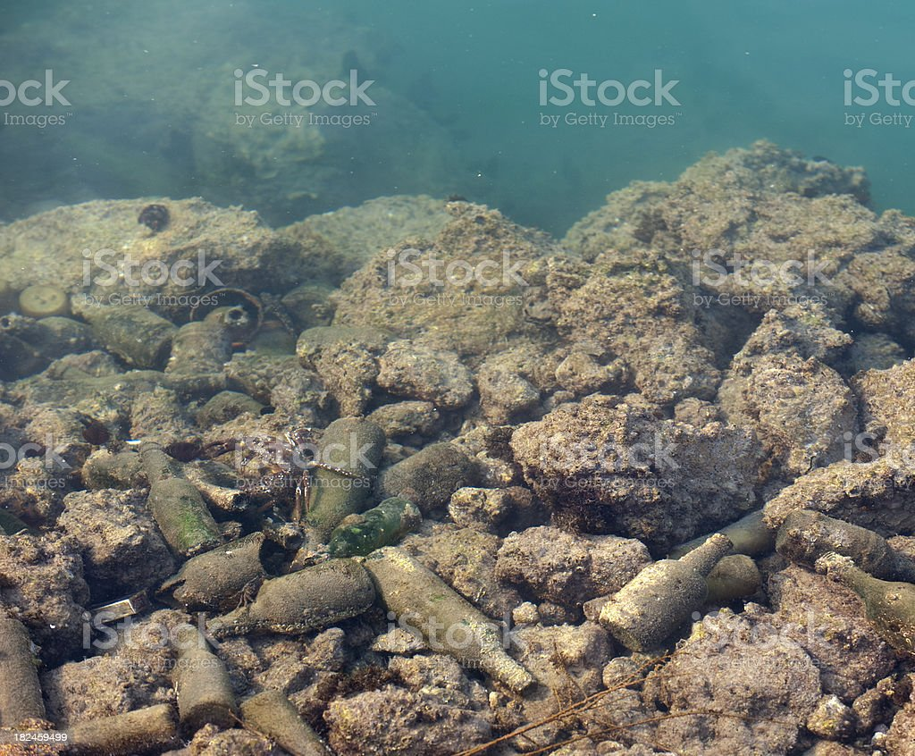 Pollution, a lot of waste material under sea royalty-free stock photo
