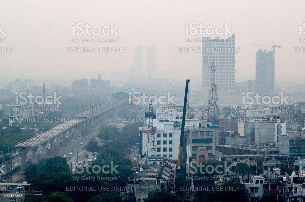 Pollution in Noida Delhi against the cityscape stock photo