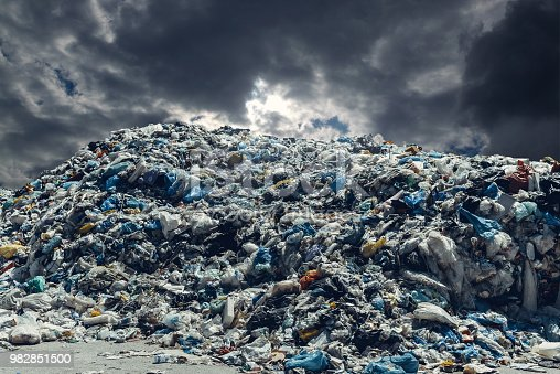 Plastic garbage with dramatic sky. Pollution concept.