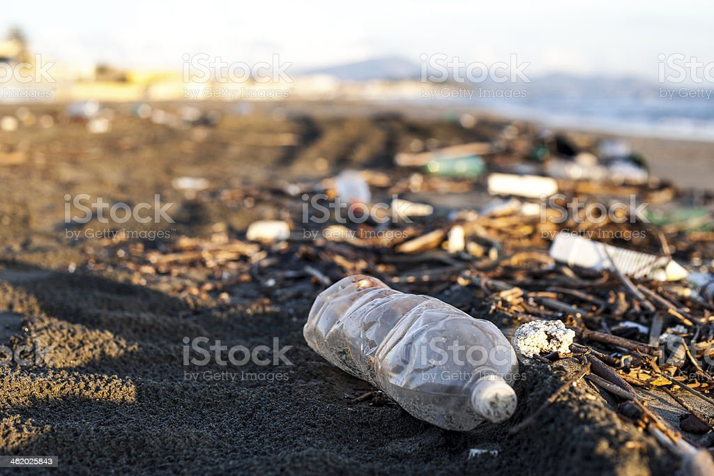 pollution, plastic water bottle on a beach stock photo