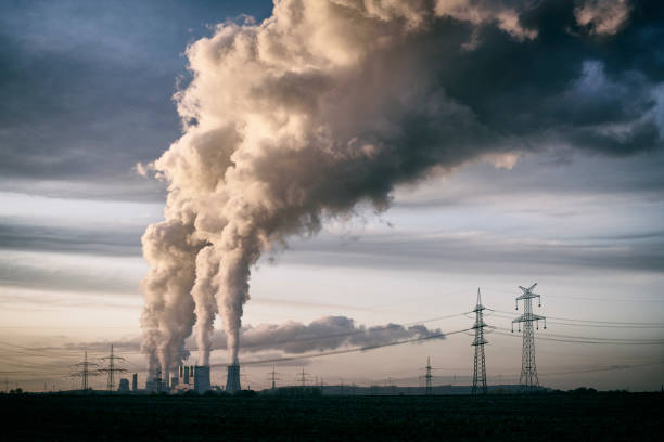 Pollution spilling into the sky from a cola fired power plant stock photo