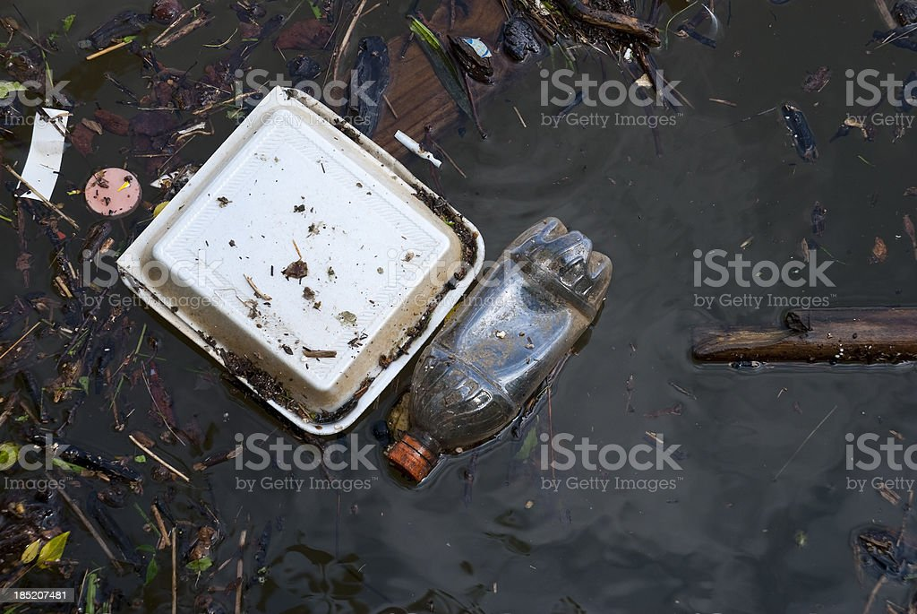 Pollution - trash in waterway royalty-free stock photo