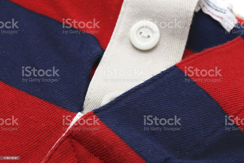 Polo shirt with torn seam royalty-free stock photo