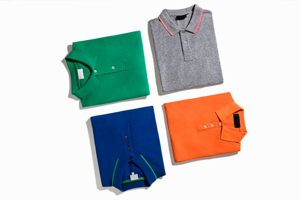 polo t-shirts - garment stock photos and pictures