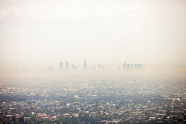 Polution And Bushfire Smoke Pollution mixed together with on going bushfire smoke in Victoria, Melbourne smog stock pictures, royalty-free photos & images