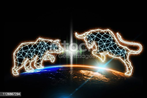 istock polygonal bull and bear shape writing by lines and dots over Part of earth with sun rise and lens flare background, Elements of this image furnished by NASA 1126867294