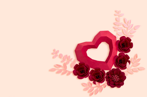 Polygonal paper heart with red flowers stock photo