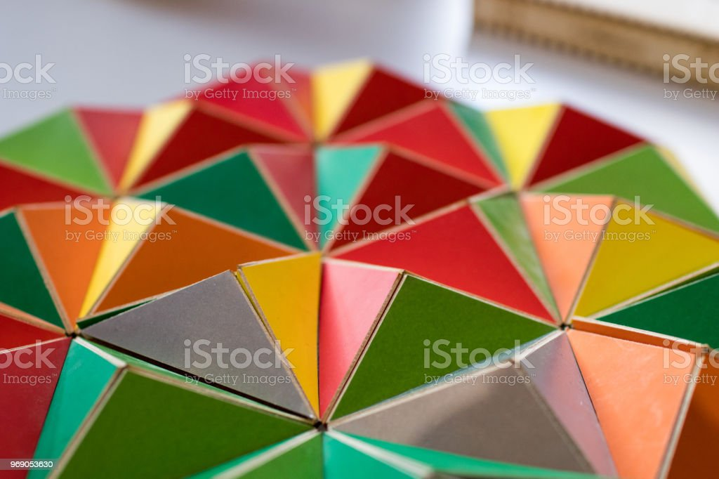 polygonal surface with colored triangles, tessellation of a three-dimensional floor with colored polygons. stock photo