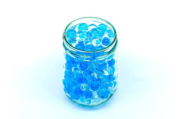 polymer gel. gel balls. balls of blue and transparent hydrogel, - leichte nachspeise stock-fotos und bilder