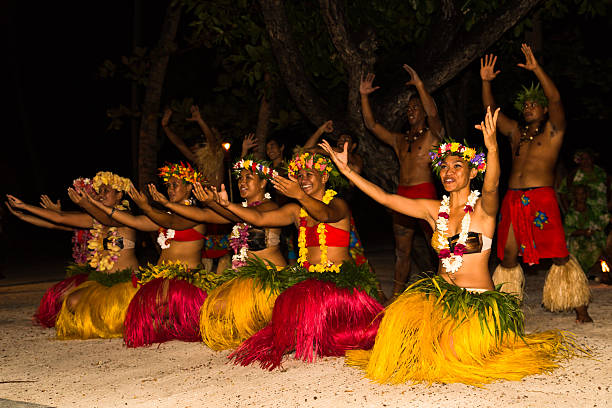 Polynesian dancers performing traditional dance during night show. Tahaa, French Polynesia - March 11, 2014: Polynesian dancers performing traditional dance. south pacific ocean stock pictures, royalty-free photos & images