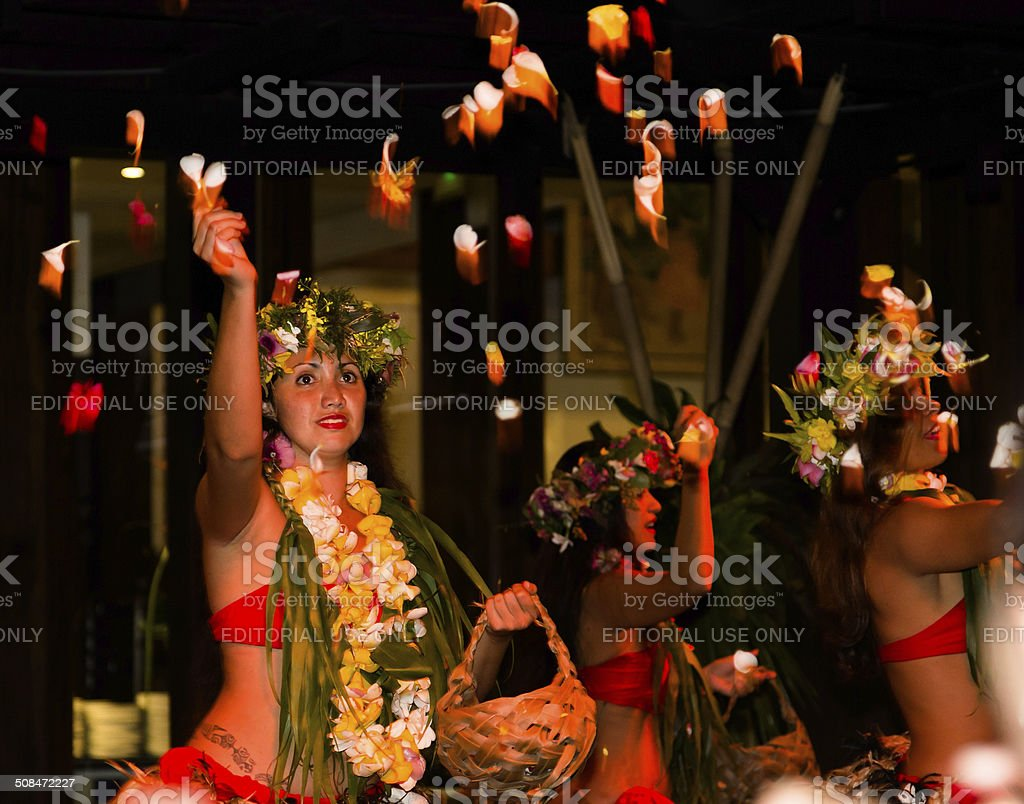 Polynesian dancers with flower petals stock photo