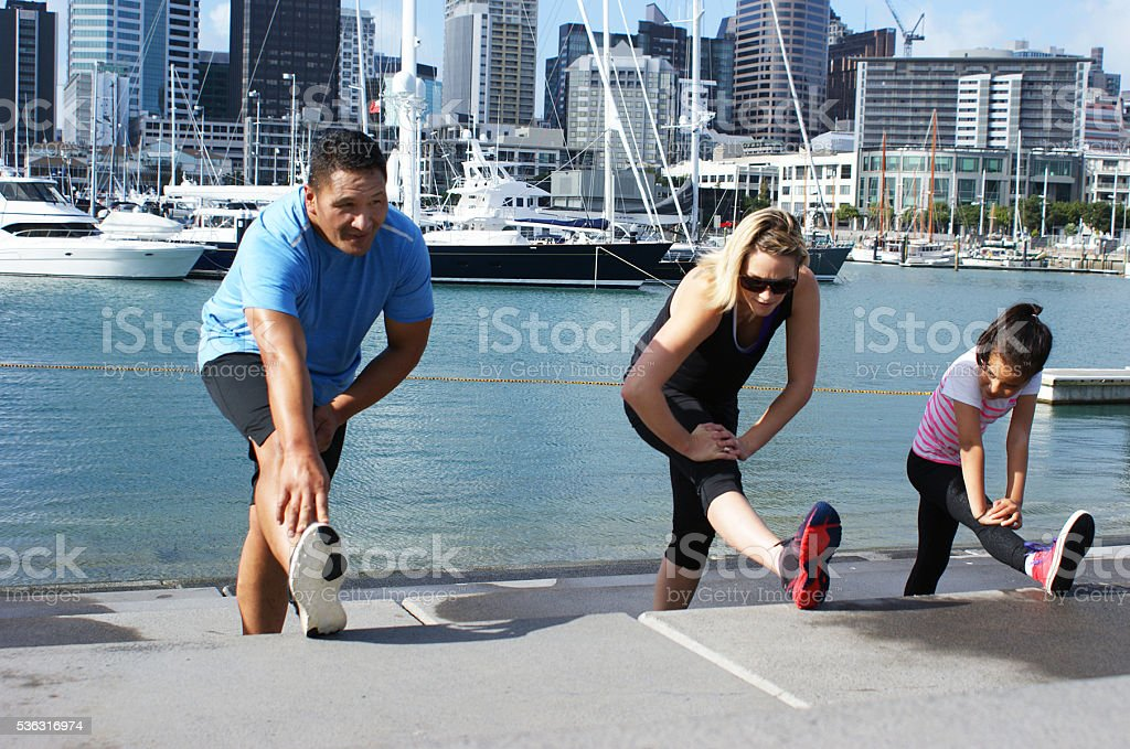Polynesian family working out together in city stock photo