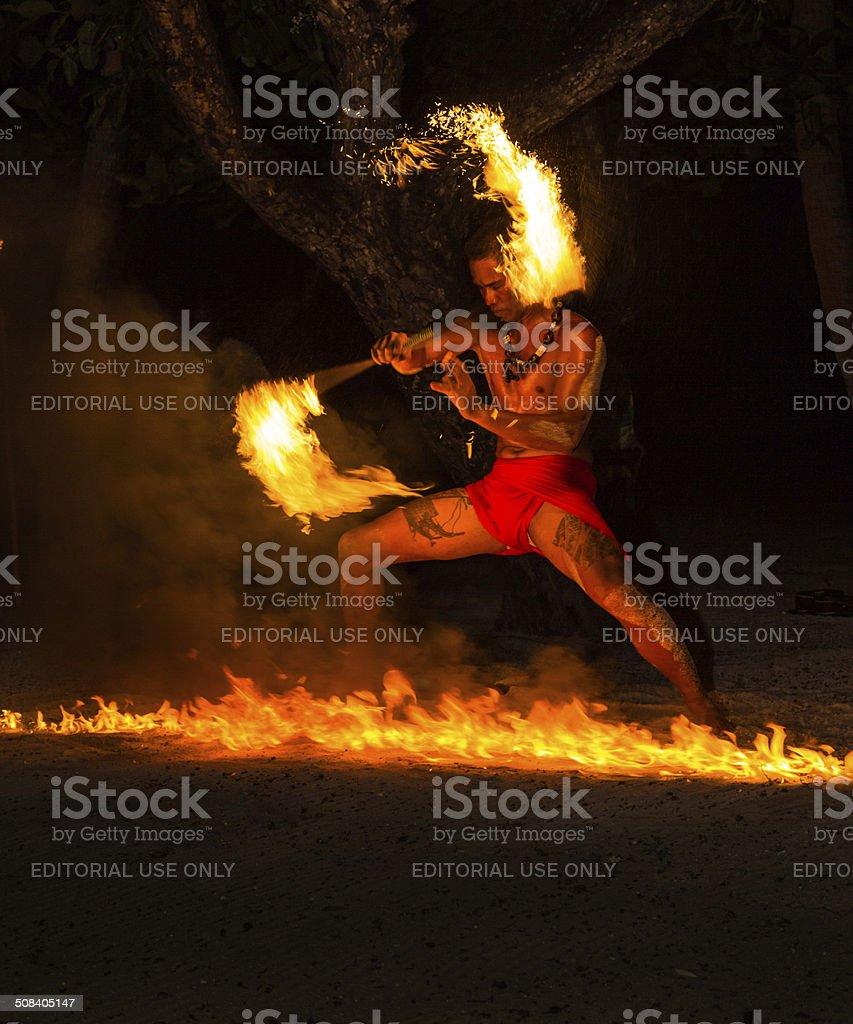 Polynesian fire dancer stock photo