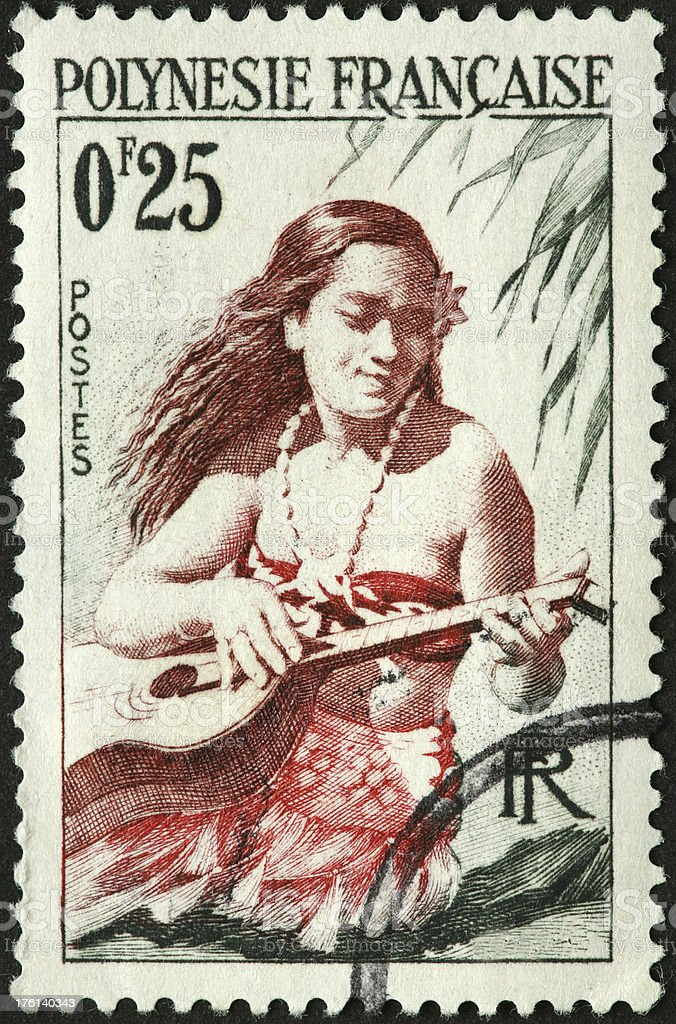 Polynesian guitar player stock photo