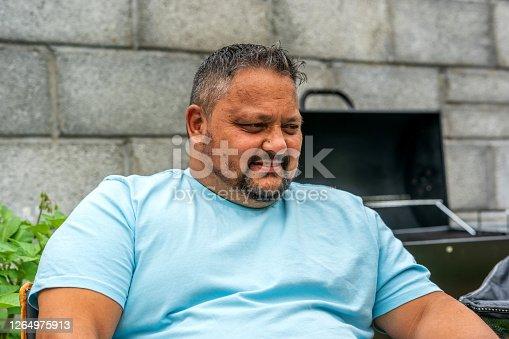 istock Polynesian man backyard BBQ portrait 1264975913