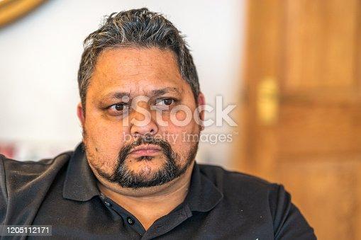 Polynesian man making serious face portrait