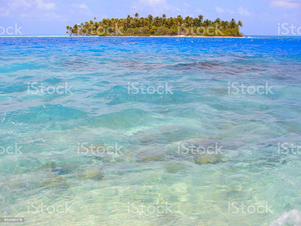 Polynesian Tropical Summer paradise: dramatic Sandy turquoise tropical beach and Green Palm Trees over water, dreamlike Bora Bora island , Tahiti motus – Idyllic French Polynesia stock photo