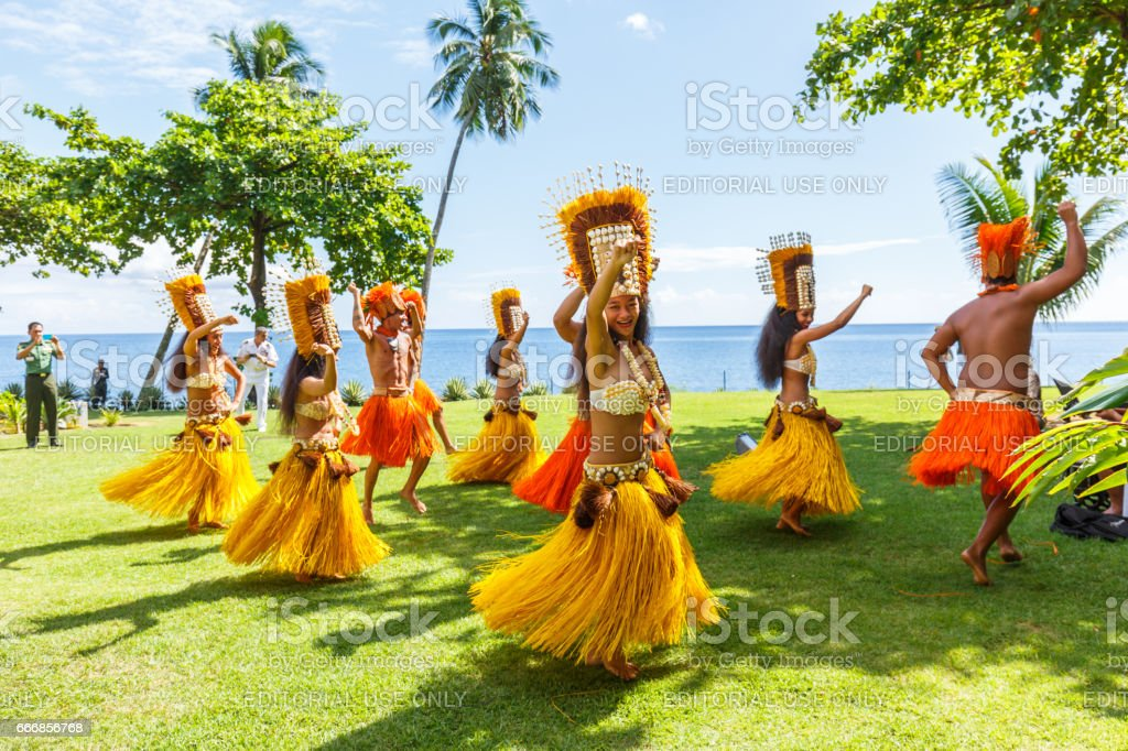 Polynesian women perform traditional dance in Tahiti  Papeete, French Polynesia. Polynesian dances are major tourist attraction of luxury resorts of French Polynesia stock photo
