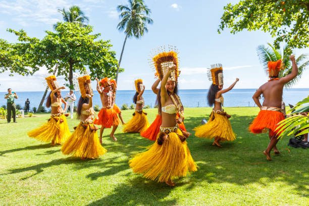 Polynesian women perform traditional dance in Tahiti  Papeete, French Polynesia. Polynesian dances are major tourist attraction of luxury resorts of French Polynesia PAPEETE, FRENCH POLYNESIA – APRIL 19, 2017 : Polynesian women perform traditional dance in Tahiti  Papeete, French Polynesia. Polynesian dances are major tourist attraction of luxury resorts of French Polynesia oceania stock pictures, royalty-free photos & images