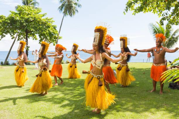 Polynesian women perform traditional dance in Tahiti Papeete, French Polynesia. stock photo