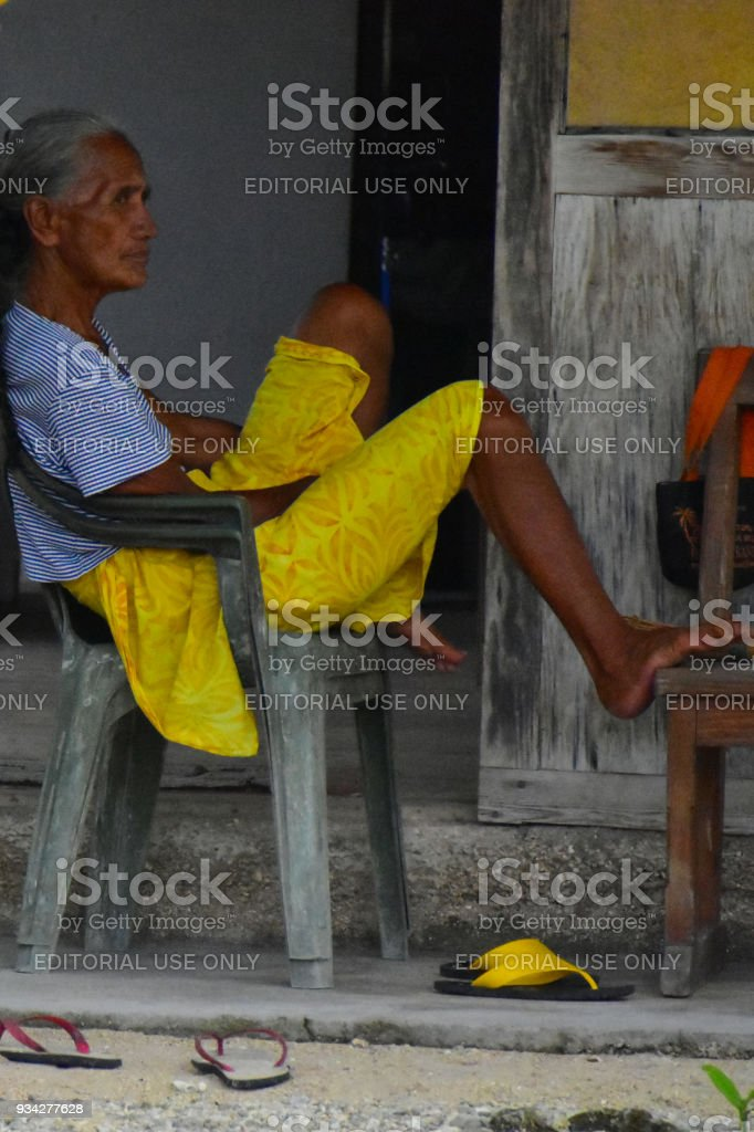 Polynesian Women relaxing on grey chair stock photo