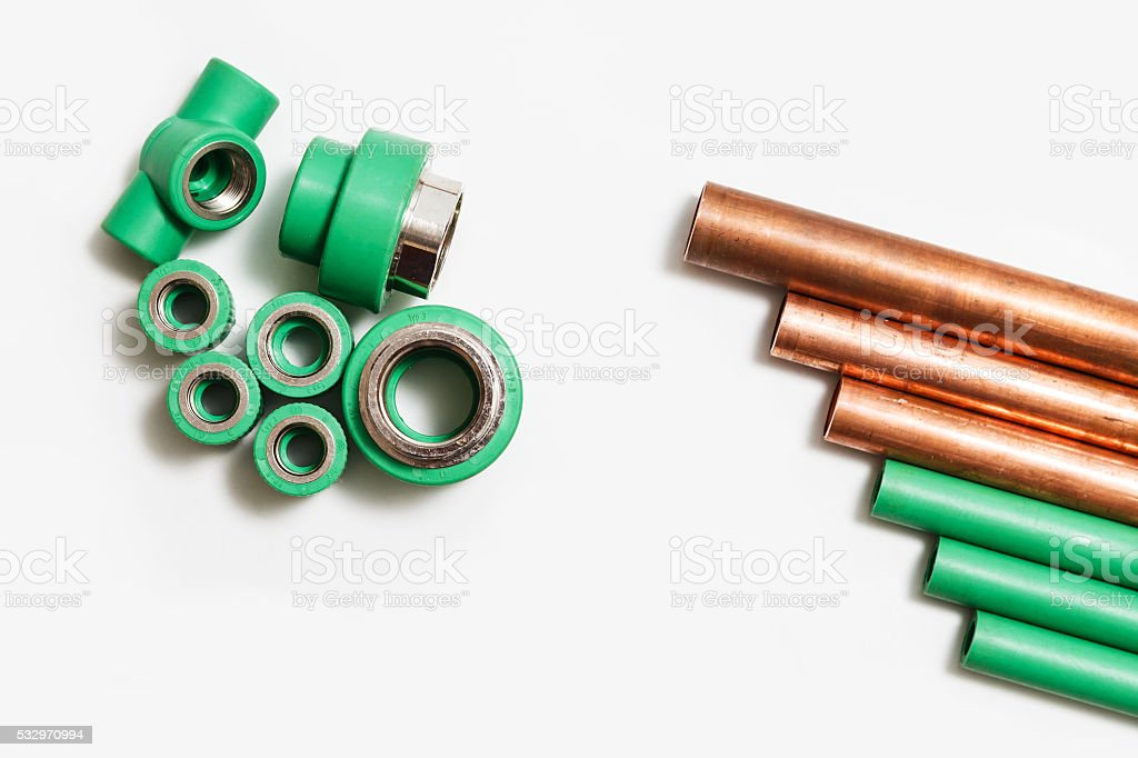 Polypropylene and copper pipes fittings and cutter stock photo