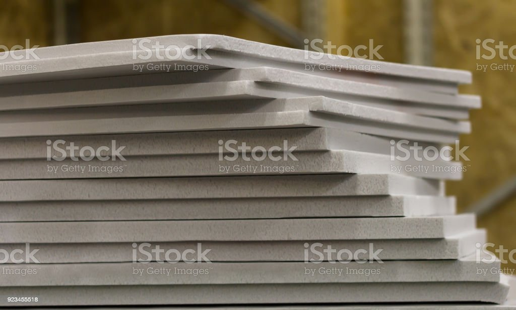 polystyrene slabs lie a tower close-up of gray color stock photo