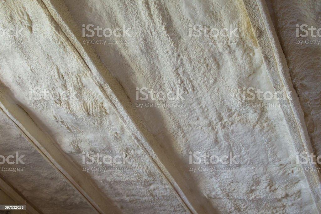Polyurea Spraying, warming foam coating of roof. stock photo
