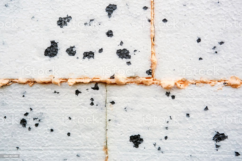 Polyurethane insulation foam between polystyrene foam. stock photo
