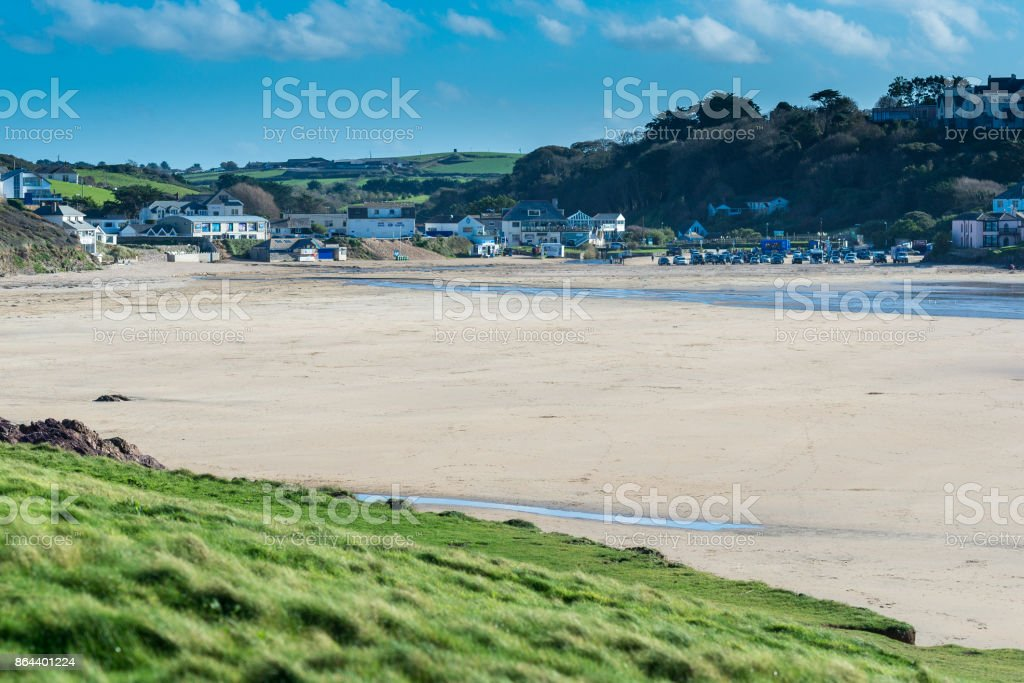 Polzeath beach is a natural sandy beach popular with tourists and surfers stock photo
