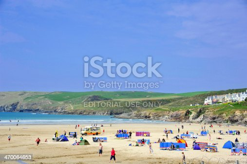 Polzeath, United Kingdom - April 27, 2011: Polzeath is a small seaside resort in Cornwall, UK.  The sandy beach is popular with tourists and surfers, and at high water the beach is totally submerged under water.