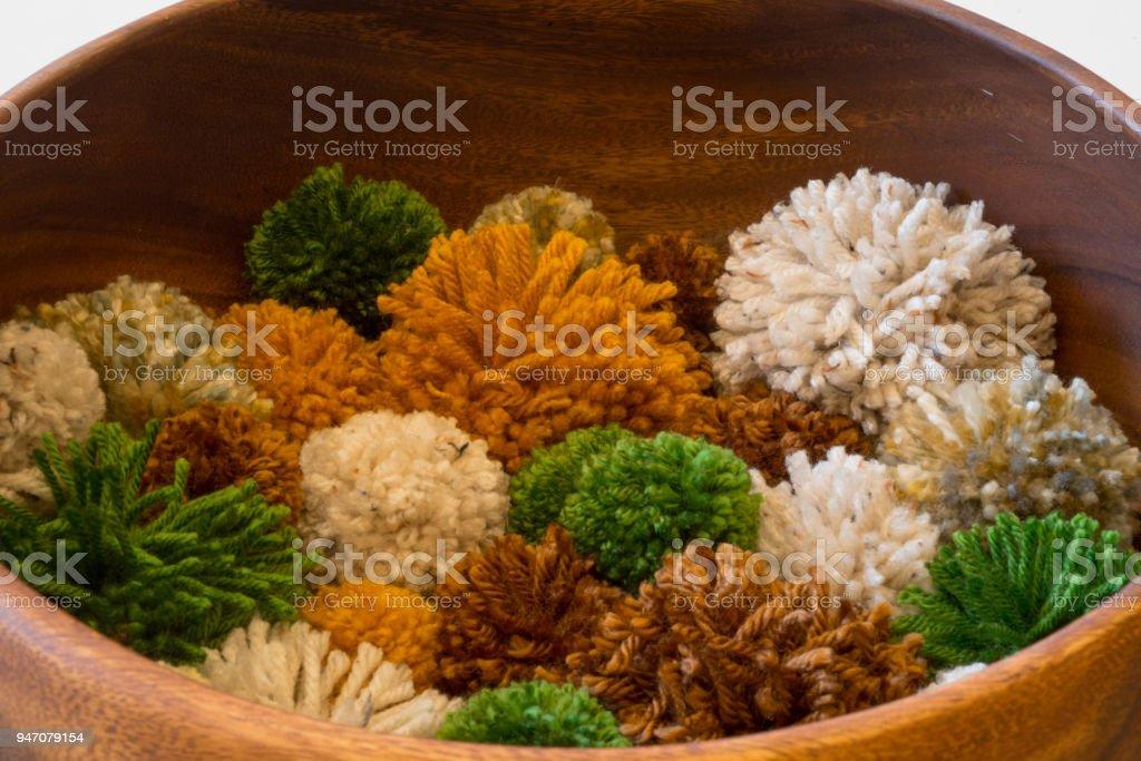 Pom Poms in Bowl Craft Background stock photo