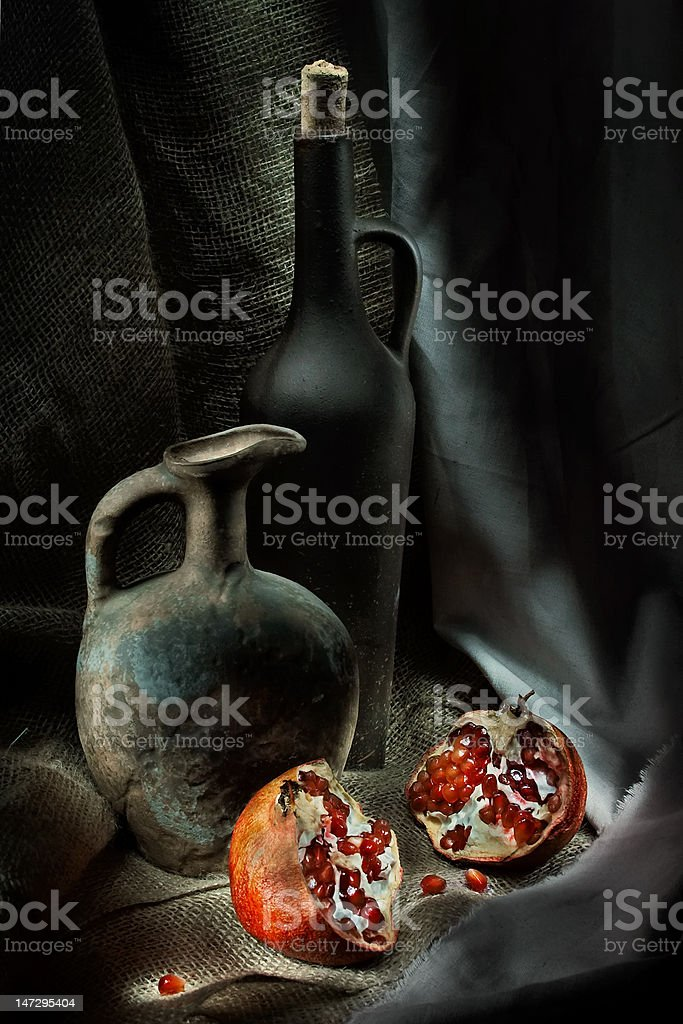pomegranate and jars royalty-free stock photo