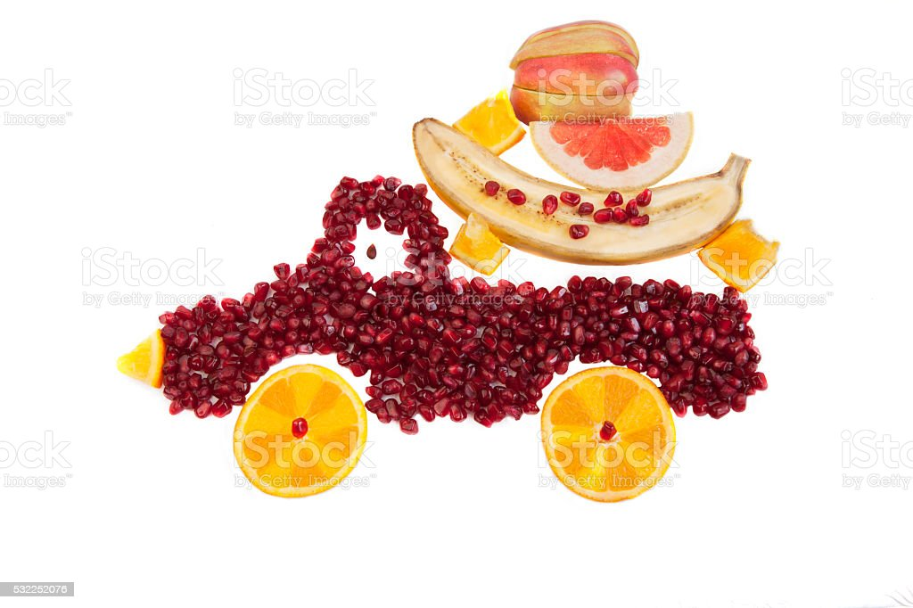 Pomegranate and orange  as shape of lorry isolated stock photo