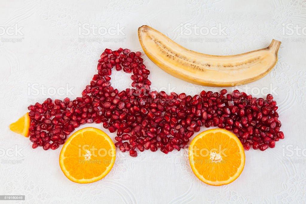 Pomegranate and orange  as shape of lorry stock photo