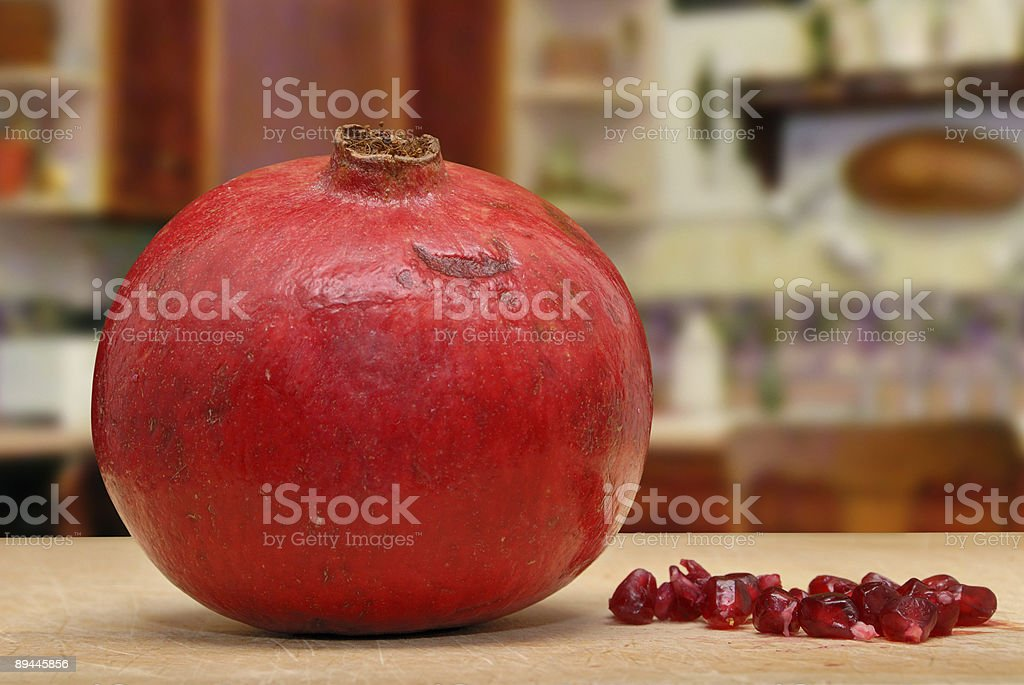 Pomegranate and seeds royalty-free stock photo