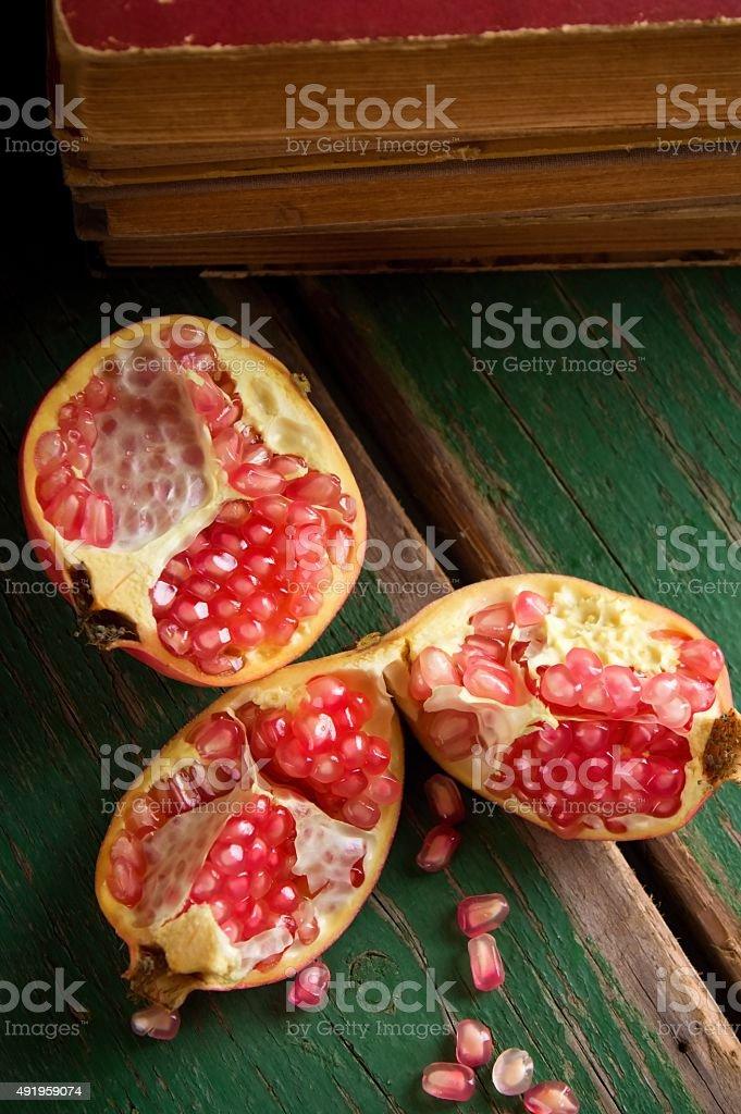 Pomegranate divided to three parts stock photo
