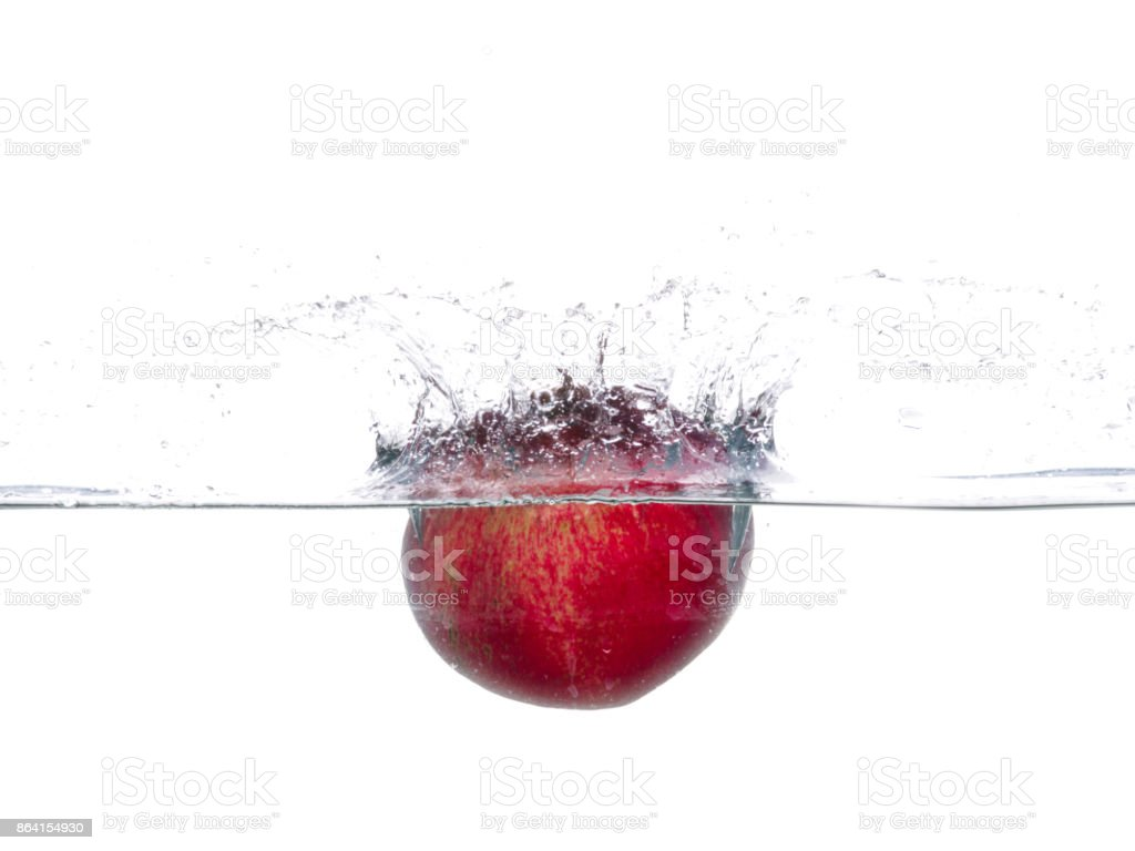 Pomegranate fall in water. Drops of water. Isolated white background royalty-free stock photo