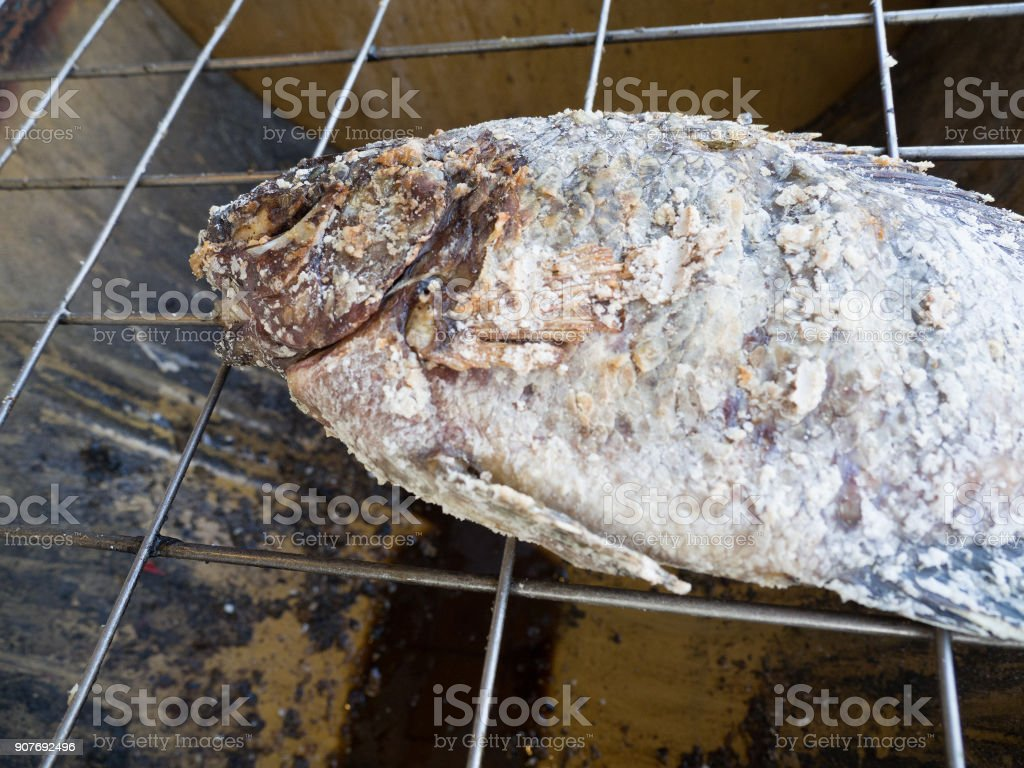 Pomegranate fish with salt and then burned. The taste of fish is sweet and fragrant. stock photo