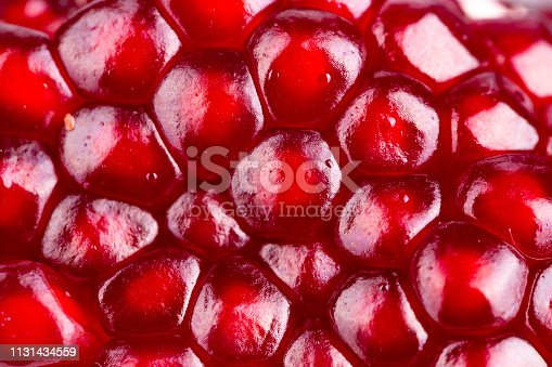 pomegranate fruit grain closeup. clearly visible grain texture and gloss. space for text