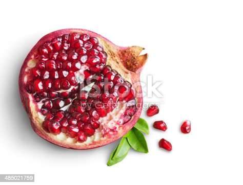 Juicy pomegranate fruit isolated on white background