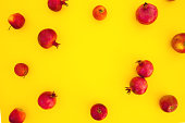Pomegranate fuits isolated on yellow background. Food background. Flat lay, top view