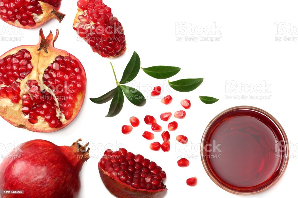 Pomegranate juice with pomegranate isolated on a white background top view - Royalty-free Alimentação Saudável Foto de stock
